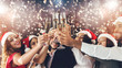 canvas print picture - Diverse friends clinking with champagne glasses on New Year's Eve