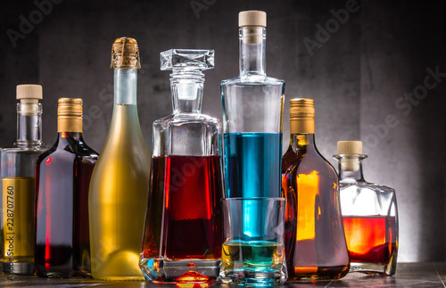 Poster Bar Carafe and bottles of assorted alcoholic beverages.