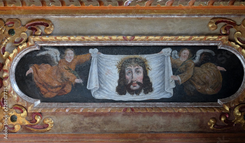 Fotografie, Obraz  Veil of Veronica altarpiece on the main altar in the chapel of St