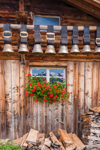Old Cow Bells Under The Roof Of An Alpine Mountain Hut, Switzerland