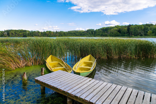 Boats on wooden jetty in a lake