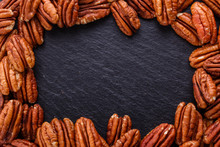 Delicious Pecan Nuts On A Dark...