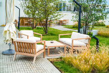 Outdoor Patio With Wooden Armc...