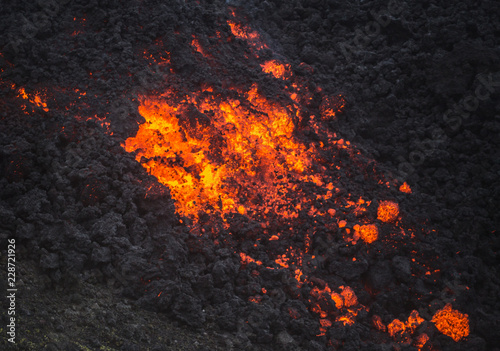 Fotografia  Red hot volcanic rock rolls down the side of the active Pacaya volcano, Guatemal
