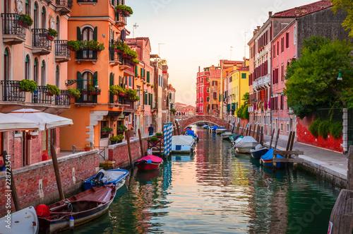 Traditional narrow canal with gondolas in Venice, Italy © Olena Z