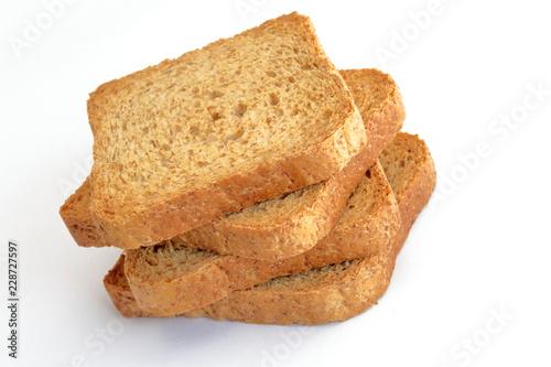 fette biscottate integrali su sfido bianco Fototapet