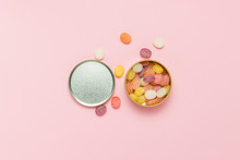 Multicolored Lollipops In A Round Can On A Gently Pink Backgroun