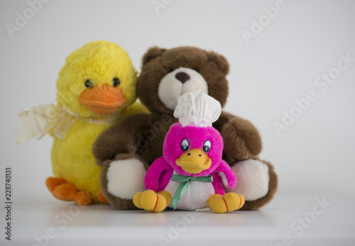 Fotografie, Obraz  Teddy plush, yellow gosling plush, pink gosling yellow plush