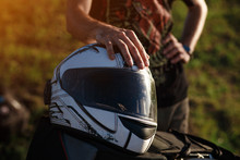 A White Motorcycle Helmet Is L...
