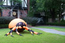 The House Is Decorated For Halloween:Huge Inflatable Spider Near The Entrance To The House And The Web. Evening, Houston, Texas, United States