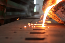 Casting Iron By Green Sand Process ; Technology For Casting, In The Metal Industry, The Process That Molten Metal Is Poured  Into A Mold , Where It Solidifies Into Shape , Industrial Background