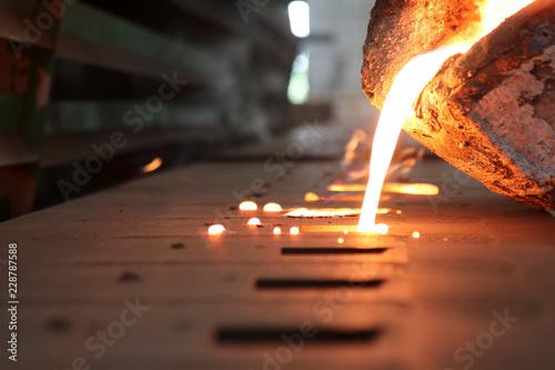 Valokuva  Iron molten metal pouring in sand mold