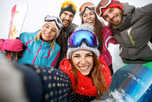 Happy Skiers On Mountain