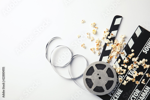 Flat lay composition with popcorn and space for text on white background. Cinema snack