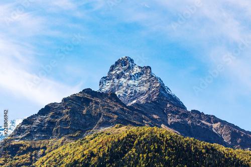 Deurstickers Asia land mountain peak over Dombay resort village