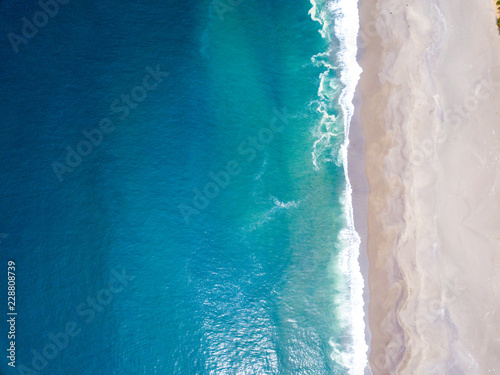Aerial view of the ocean waves washing on the coast of the Pacific ocean Fototapeta