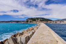 The Breakwater In The Port Of Nice, Beautiful View Of The Mediterranean Sea And Cityscape Of Nice, Cote D'azur, France.
