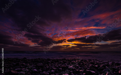 Sunrise On Praia De Igrejinh With Dramatic Colorful Sky And Rock