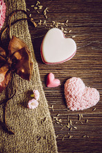 Different Color Hand Made Heart Shape Soaps On Wooden Board Background, Burlap Cloth And In Brown Tulle Gift Bag. Hand Made Gift Idea Concept.