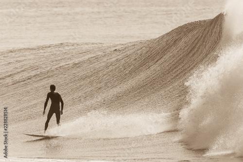 Fotografie, Tablou Surfer Rear View Surfing Sepia Wave Action