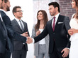 successful business partners shaking hands