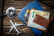 canvas print picture - Medical tourism concept - passports, stethoscope, airplane, money top view