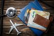 Leinwandbild Motiv Medical tourism concept - passports, stethoscope, airplane, money top view