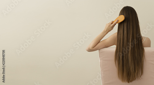 Foto image of attractive woman brushing her  long hair, space for text