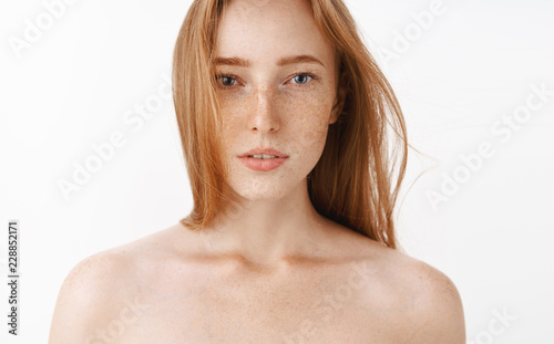 Close-up shot of sensual feminine and attractive redhead female standing naked o Poster Mural XXL