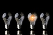 creativity startup business ideas concept with glow light bulb on black background