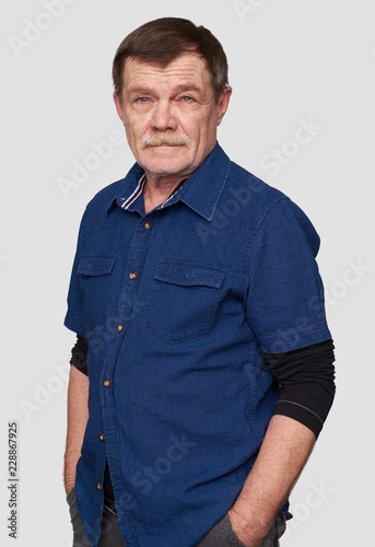 handsome senior man smiling. Isolated Canvas Print