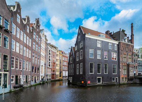Photo  Facades of old historic Houses over canal water, dutch scenery of Amsterdam, Net