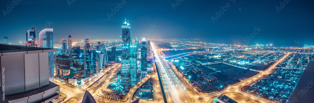 Fototapety, obrazy: Spectacular urban skyline with colourful city illuminations. Aerial view on highways and skyscrapers of Dubai, United Arab Emirates.