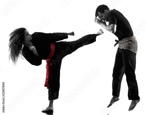 Fotografia  one caucasian woman practicing martial arts Kung Fu Pencak Silat in studio isola