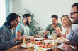 canvas print picture - Group Of Happy Young Friends Enjoying Dinner At Home. Group of multiethnic friends enjoying dinner party