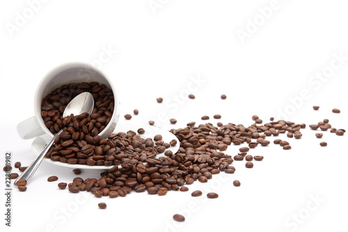 Overturned Coffee Beans and Cup Isolated on White Background with copy space