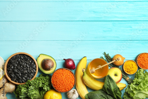 Flat lay composition with natural products and space for text on wooden background. Home remedies for asthma