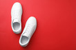 Leinwanddruck Bild - Pair of sneakers on color background, flat lay. Space for text