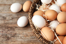 Basket With Raw Chicken Eggs O...