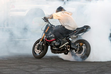 Biker Burning Tire And Creating Smoke On Bike In Motion