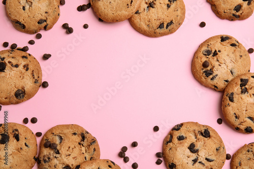 Delicious chocolate chip cookies on color background, flat lay Wallpaper Mural