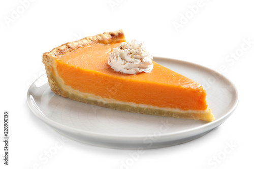 Plate with piece of fresh delicious homemade pumpkin pie on white background