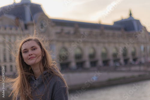 Fotografie, Tablou young woman in paris in front of Le Louvre