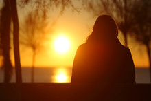 Silhouette Of A Lonely Woman W...