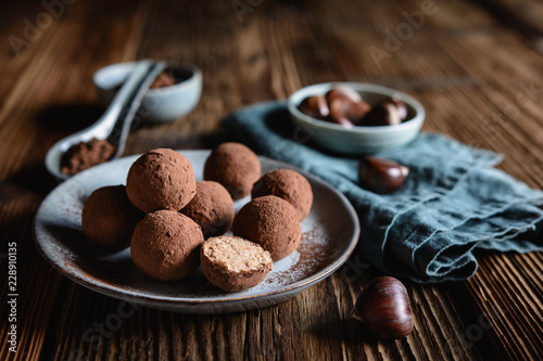 Poster Confiserie Chestnut truffles coated with cocoa powder