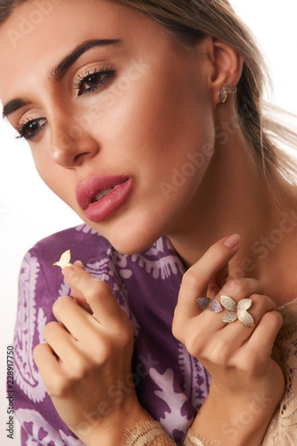 Beauty fashion blonde girl face make-up, studio shot. Beautiful young woman portrait with nice face and healthy skin isolated on white background with copy space, close-up