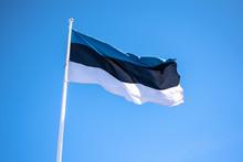 Estonian Flag Against The Blue Sky. Tallinn, Estonia. Estonia Flag Waving On The Wind. Bottom View