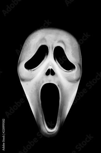 Photo Maschera spaventosa della paura su sfondo nero