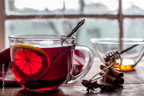 Tea with lemon on table with windows view