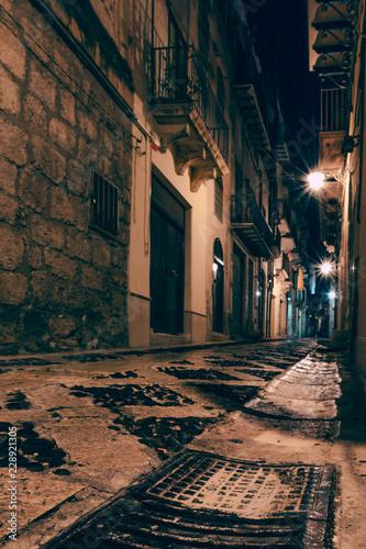 Cuadros en Lienzo Night, ancient, historical city. Alcamo, Sicily, Italy